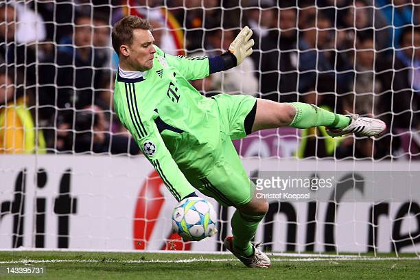Manuel Neuer of Bayern saves a penalty against kaka of Real Madrid during the UEFA Champions League semi final second leg match between Real Madrid...