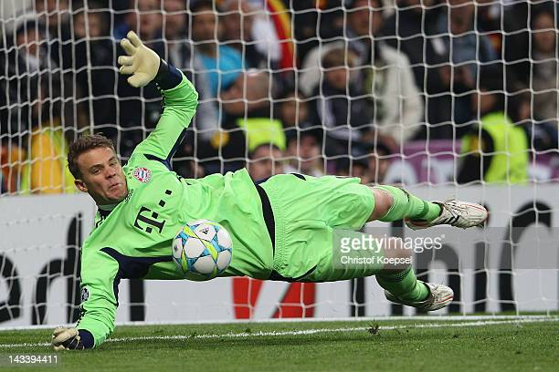 Manuel Neuer of Bayern saves a penalty of Cristiano Ronaldo of Real Madrid not in the pictuKarim Benzemaduring the UEFA Champions League semi final...