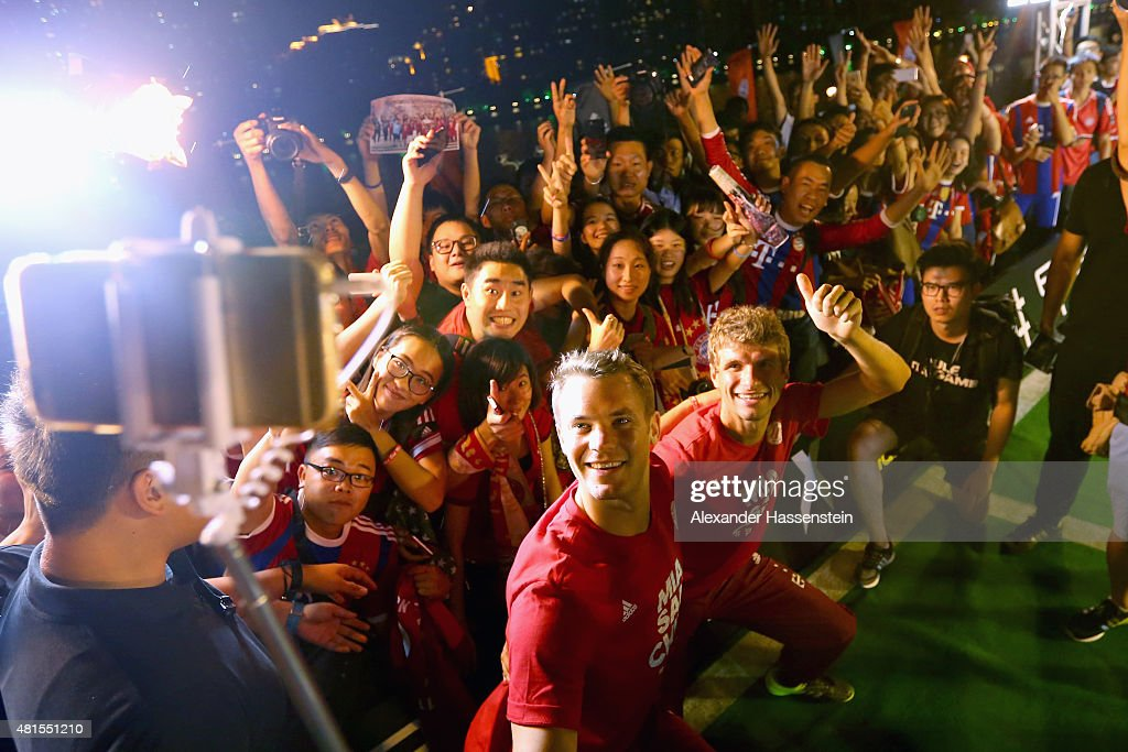 Manuel Neuer of FC Bayern Muenchen and his team mate Thomas Mueller (R) attends a fun football match at adidas marketing event on a cruise boat of the Guangzhou Pearl River at Dashatou Wharf on day 6 of the FC Bayern Audi China Summer Pre-Season Tour on July 22, 2015 in Guangzhou, China.