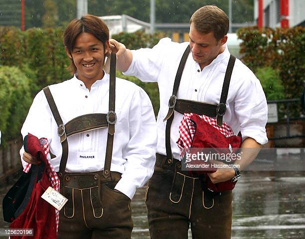 Manuel Neuer of FC Bayern Muenchen arrives with his team mate Takashi Usami for the Paulaner photocall at Bayern Muenchen`s trainings ground Saebener...