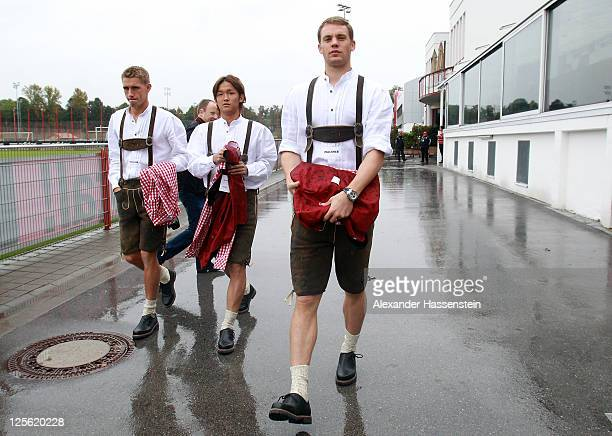 Manuel Neuer of FC Bayern Muenchen arrives with his team mates Takashi Usami and Nils Petersen for the Paulaner photocall at Bayern Muenchen`s...