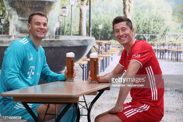 Manuel Neuer of FC Bayern Muenchen attends with his team mate Robert Lewandowski the FC Bayern Muenchen and Paulaner photo session at Nockherberg on...