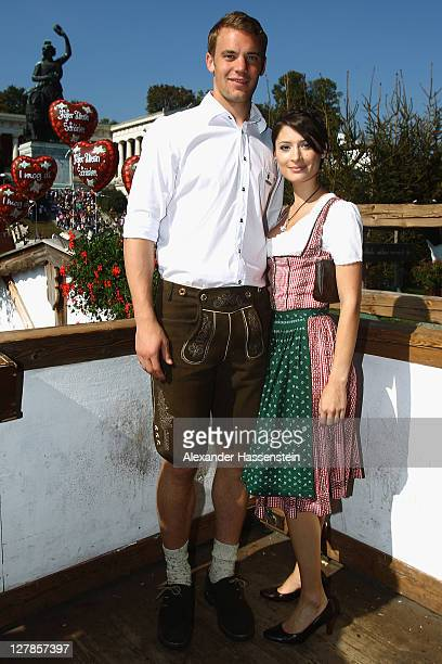 Manuel Neuer of FC Bayern Muenchen attends with Katrin the Oktoberfest beer festival at the Kaefer Wiesnschaenke tent on October 2, 2011 in Munich,...