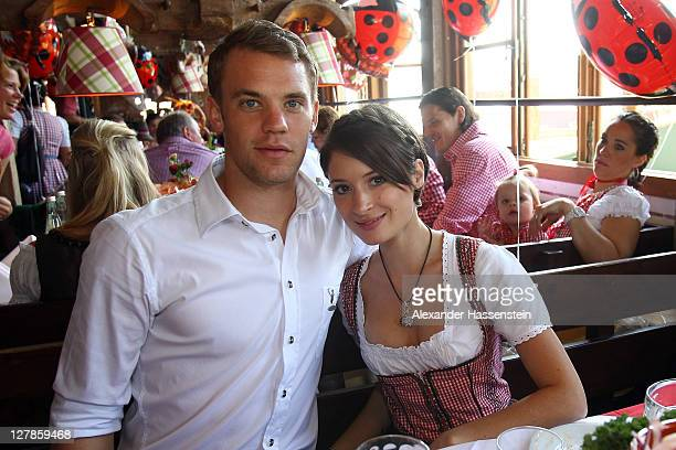 Manuel Neuer of FC Bayern Muenchen attends with Katrin the Oktoberfest beer festival at the Kaefer Wiesnschaenke tent on October 2 2011 in Munich...