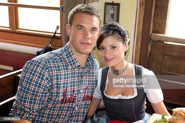 Manuel Neuer of FC Bayern Muenchen attends with Katrin the Oktoberfest beer festival at the Kaefer Wiesnschaenke tent on October 7, 2012 in Munich,...