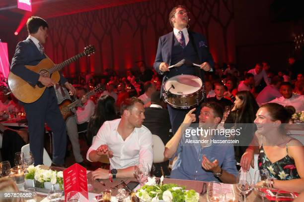 Manuel Neuer of FC Bayern Muenchen attends with Thomas Mueller and Lisa Mueller the FC Bayern Muenchen Celebration 2018 Party at Nockherberg on May...
