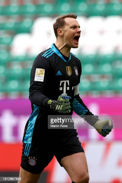 Manuel Neuer of FC Bayern Muenchen celebrates after teammate Jamal Musiala of FC Bayern Muenchen scores their team's third goal during the Bundesliga...