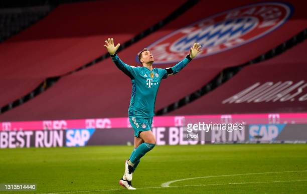 Manuel Neuer of FC Bayern Muenchen celebrates after their team's second goal scored by Joshua Kimmich during the Bundesliga match between FC Bayern...