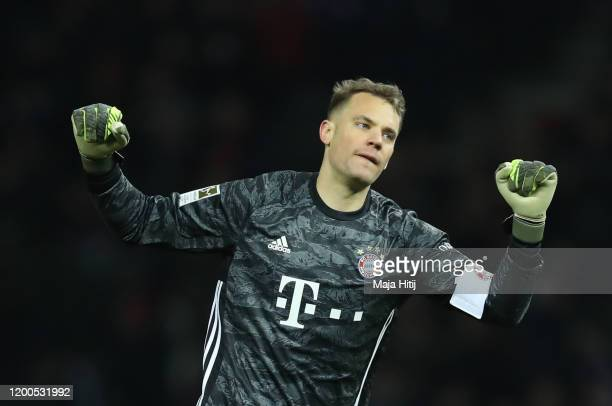 Manuel Neuer of FC Bayern Muenchen celebrates at the final whistle during the Bundesliga match between Hertha BSC and FC Bayern Muenchen at...
