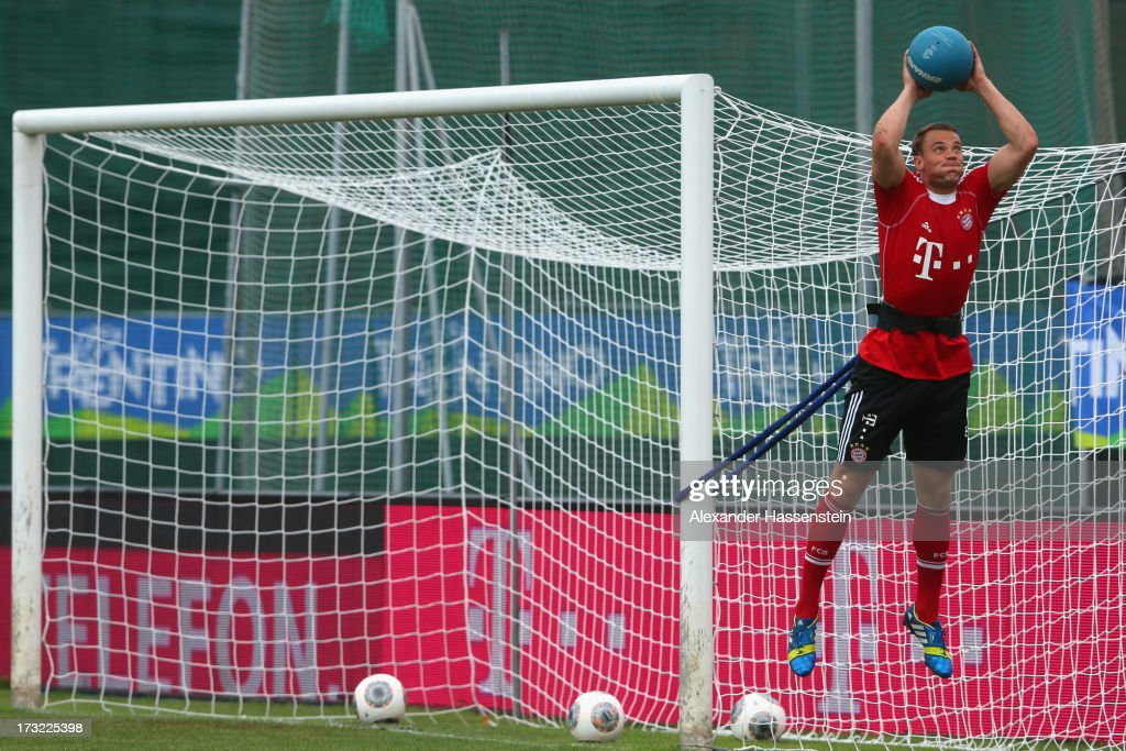 Manuel Neuer of FC Bayern Muenchen challenge for the ball during a training session at Campo Sportivo on July 10, 2013 in Arco, Italy.