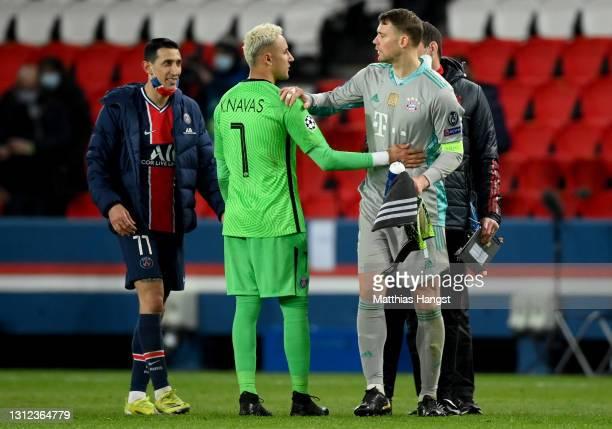 Manuel Neuer of FC Bayern Muenchen interacts with Keylor Navas of Paris Saint-Germain following the UEFA Champions League Quarter Final Second Leg...