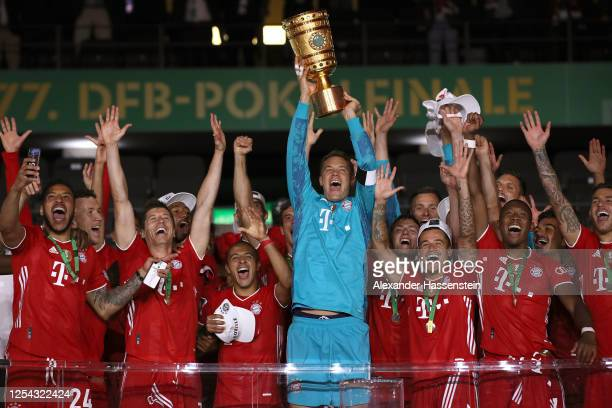 Manuel Neuer of FC Bayern Muenchen lifts the DFB Cup winners trophy in celebration after the DFB Cup final match between Bayer 04 Leverkusen and FC...