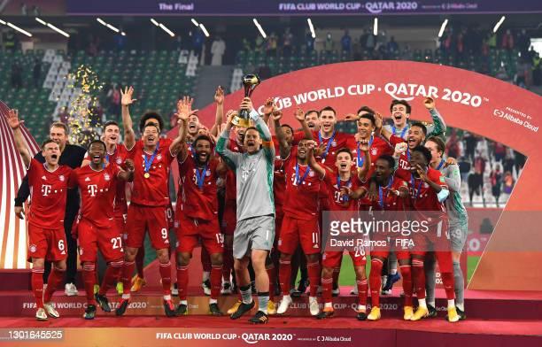 Manuel Neuer of FC Bayern Muenchen lifts the FIFA Club World Cup Qatar 2020 trophy as FC Bayern Muenchen celebrate after winning the FIFA Club World...