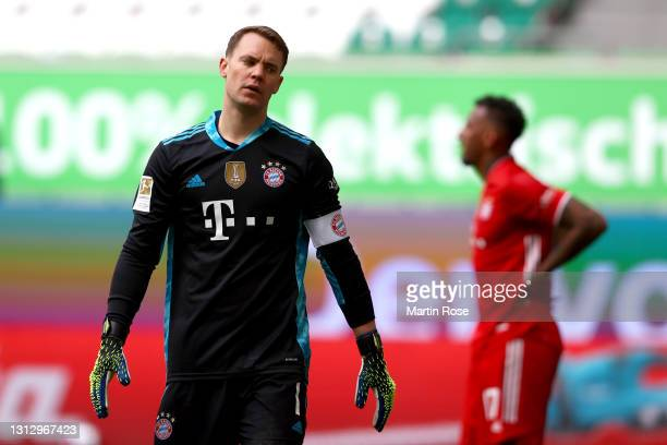 Manuel Neuer of FC Bayern Muenchen looks dejected after conceding a goal from Wout Weghorst of VfL Wolfsburg during the Bundesliga match between VfL...