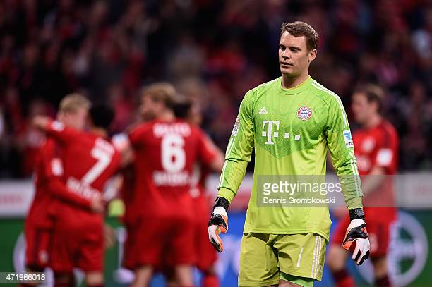 Manuel Neuer of FC Bayern Muenchen looks on as Julian Brandt of Bayer Leverkusen celebrates the second goal during the Bundesliga match between Bayer...