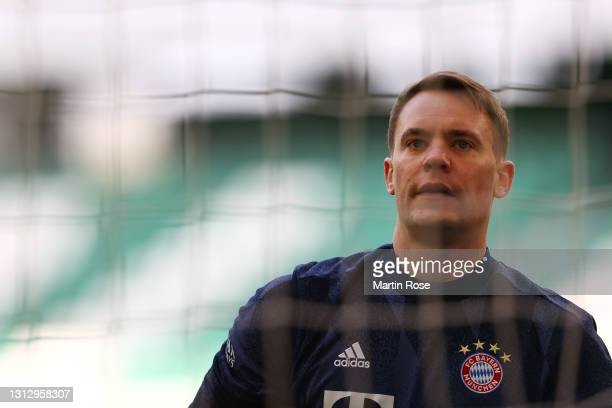 Manuel Neuer of FC Bayern Muenchen looks on during the warm up prior to the Bundesliga match between VfL Wolfsburg and FC Bayern Muenchen at...