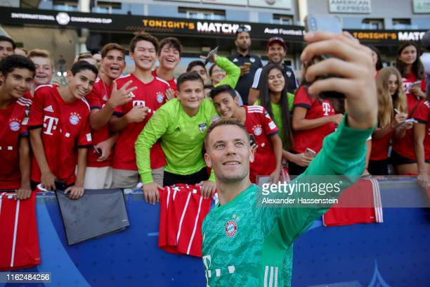 Manuel Neuer of FC Bayern Muenchen poses for selfies with Bayern Muenchen supporters after a FC Bayern Muenchen training session at Dignity Health...