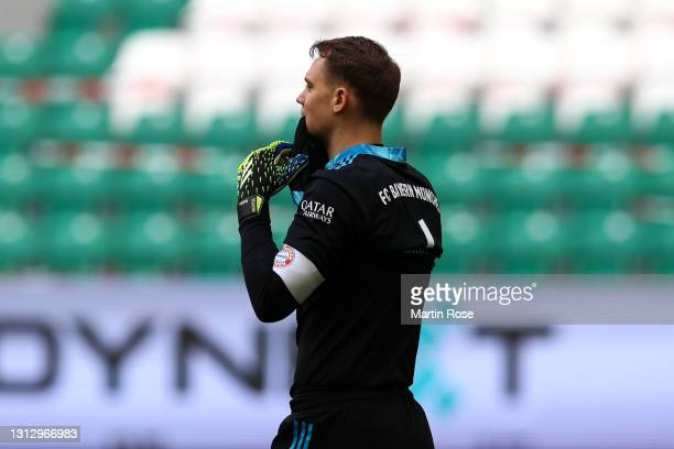 Manuel Neuer of FC Bayern Muenchen reacts during the Bundesliga match between VfL Wolfsburg and FC Bayern Muenchen at Volkswagen Arena on April 17,...