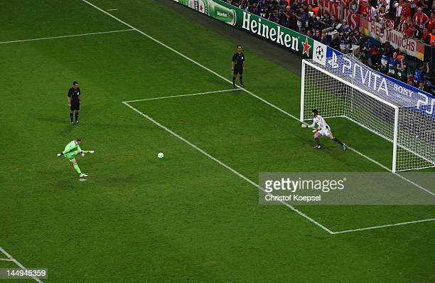 Manuel Neuer of FC Bayern Muenchen scores a penalty in the shoot out past Petr Cech of Chelsea during UEFA Champions League Final between FC Bayern...