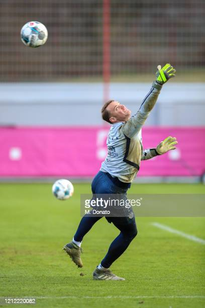 Manuel Neuer of FC Bayern Muenchen tries to save a shot during a training session at Saebener Strasse training ground on March 13 2020 in Munich...