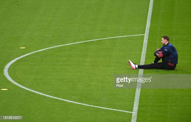 Manuel Neuer of FC Bayern Muenchen warms up prior to the Bundesliga match between FC Bayern Muenchen and Bayer 04 Leverkusen at Allianz Arena on...