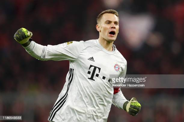 Manuel Neuer of FC Bayern Munich celebrates his team's first goal during the Bundesliga match between FC Bayern Muenchen and Borussia Dortmund at...