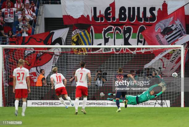 Manuel Neuer of FC Bayern Munich fails to stop Emil Forsberg of RB Leipzig from scoring his team's first goal from a penalty during the Bundesliga...