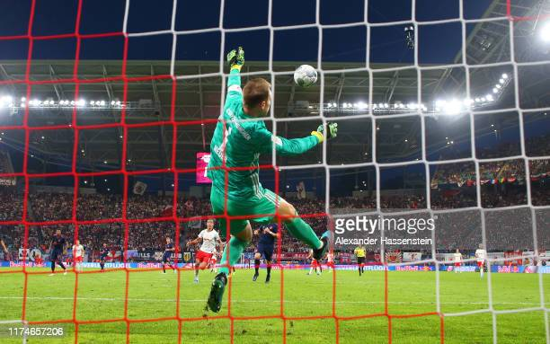 Manuel Neuer of FC Bayern Munich makes a spectacular save during the Bundesliga match between RB Leipzig and FC Bayern Muenchen at Red Bull Arena on...
