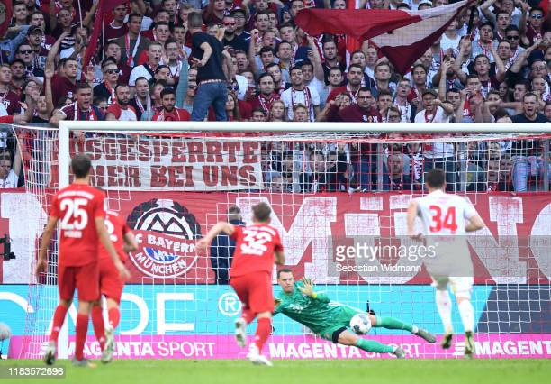 Manuel Neuer of FC Bayern Munich saves a penalty from Sebastian Andersson of 1. FC Union Berlin during the Bundesliga match between FC Bayern...