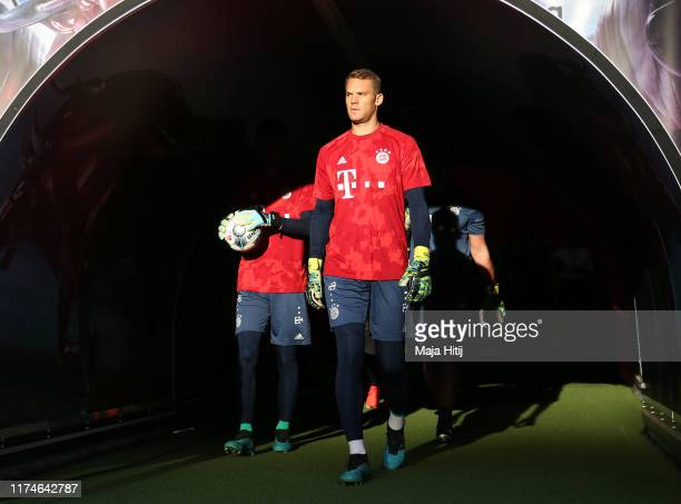 Manuel Neuer of FC Bayern Munich walks out of the tunnel to warm up prior to the Bundesliga match between RB Leipzig and FC Bayern Muenchen at Red...