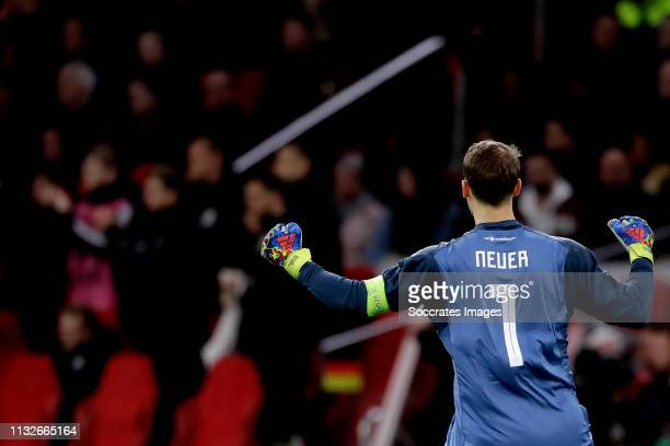 Manuel Neuer of Germany celebrates 23 during the EURO Qualifier match between Holland v Germany at the Johan Cruijff Arena on March 24 2019 in...