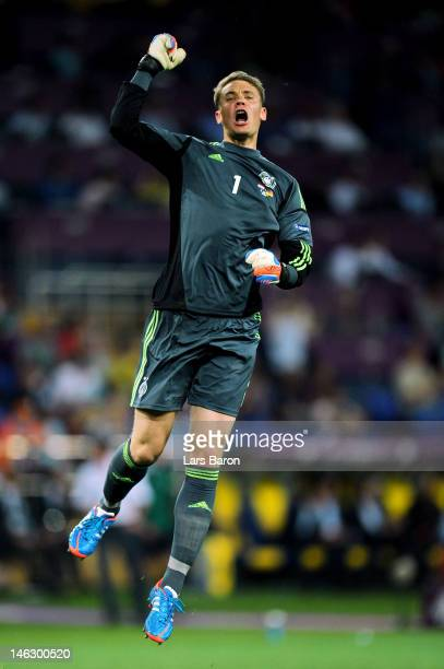 Manuel Neuer of Germany celebrates after Mario Gomez of Germany scored the opening goal during the UEFA EURO 2012 group B match between Netherlands...