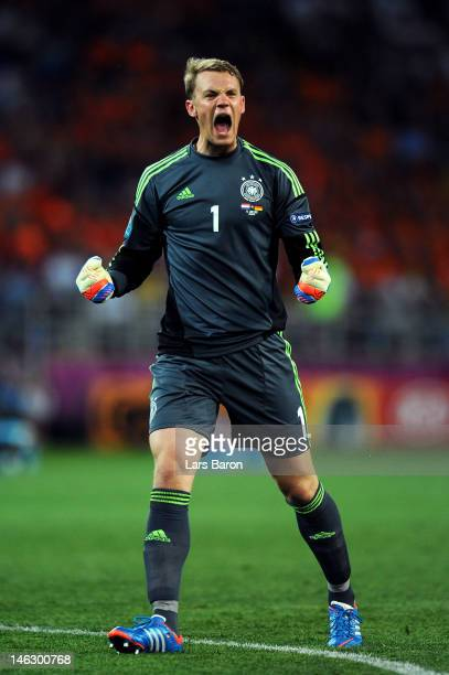 Manuel Neuer of Germany celebrates after Mario Gomez of Germany scored the second goal during the UEFA EURO 2012 group B match between Netherlands...