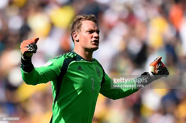 Manuel Neuer of Germany celebrates his team's first goal during the 2014 FIFA World Cup Brazil Quarter Final match between France and Germany at...