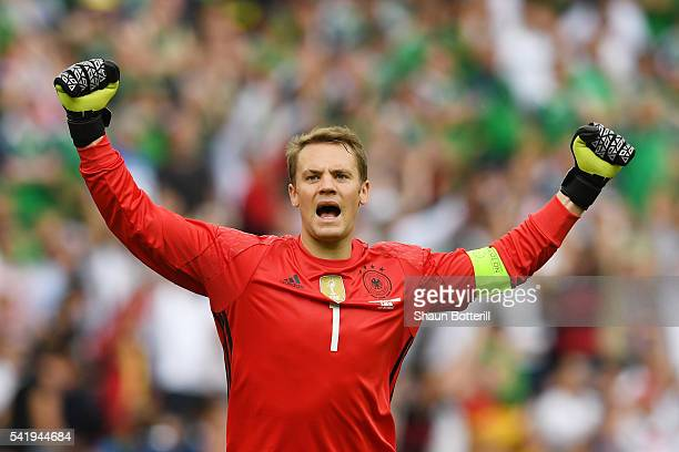 Manuel Neuer of Germany celebrates his team's first goal during the UEFA EURO 2016 Group C match between Northern Ireland and Germany at Parc des...