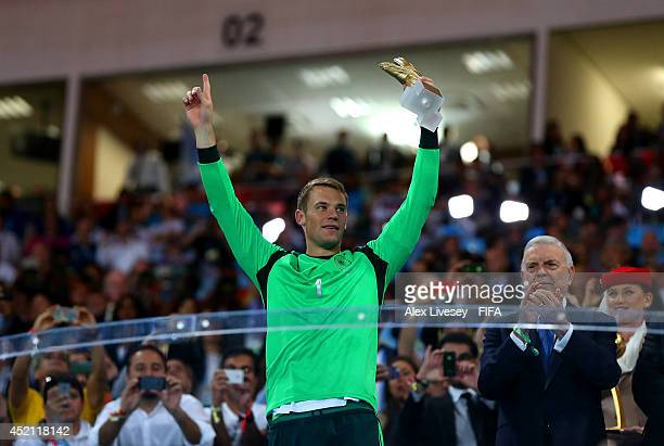 Manuel Neuer of Germany celebrates the Golden Glove during the award ceremony after the 2014 FIFA World Cup Brazil Final match between Germany and...