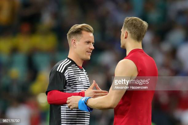 Manuel Neuer of Germany celebrates victory with teammate MarcAndre Ter Stegen during the 2018 FIFA World Cup Russia group F match between Germany and...