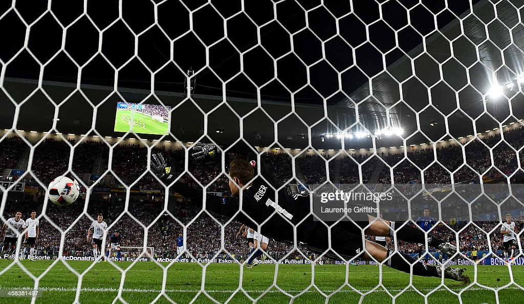 Manuel Neuer of Germany dives in vain as Leonardo Bonucci of Italy converts the penalty to score his team's first goal during the UEFA EURO 2016 quarter final match between Germany and Italy at Stade Matmut Atlantique on July 2, 2016 in Bordeaux, France.