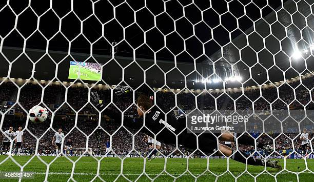 Manuel Neuer of Germany dives in vain as Leonardo Bonucci of Italy converts the penalty to score his team's first goal during the UEFA EURO 2016...