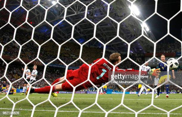 Manuel Neuer of Germany dives to make a save from Marcus Berg of Sweden during the 2018 FIFA World Cup Russia group F match between Germany and...