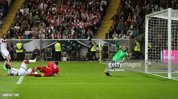 Manuel Neuer of Germany fails to stop the header by Robert Lewandowski of Poland for Poland's opening goal during the EURO 2016 Qualifier Group D...