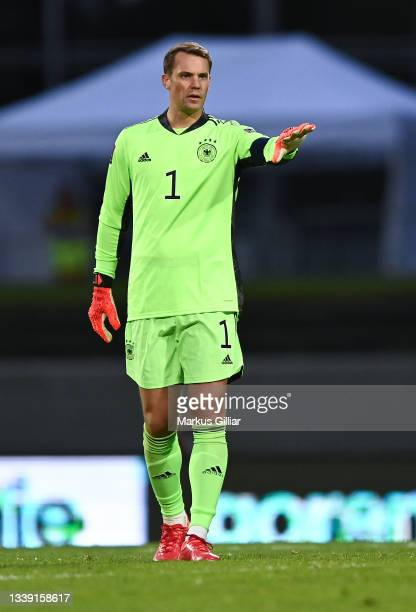 Manuel Neuer of Germany gives his team instructions during the 2022 FIFA World Cup Qualifier match between Iceland and Germany at on September 08,...
