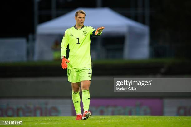 Manuel Neuer of Germany gives his team instructionsduring the 2022 FIFA World Cup Qualifier match between Iceland and Germany at on September 08,...