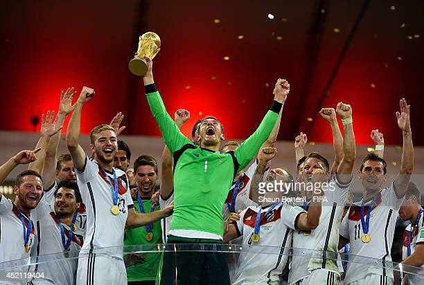 Manuel Neuer of Germany holds the World Cup to celebrate with his teammates during the award ceremony after the 2014 FIFA World Cup Brazil Final...