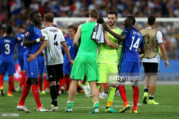 Manuel Neuer of Germany is consoled by Hugo Lloris of France at fulltime following the UEFA Euro 2016 Semi Final match between Germany and France at...