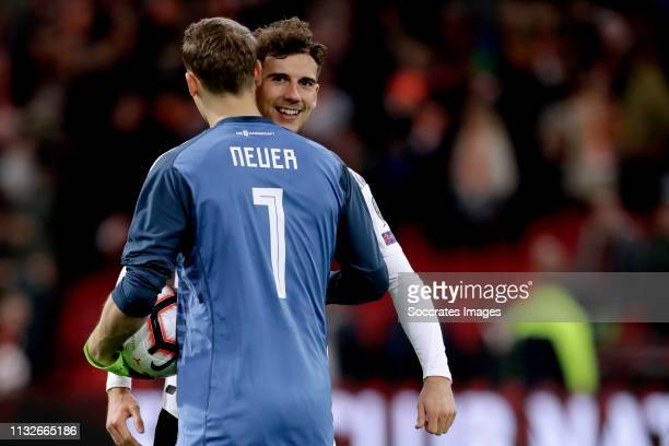 Manuel Neuer of Germany Leon Goretzka of Germany celebrates the victory during the EURO Qualifier match between Holland v Germany at the Johan...