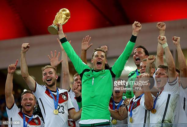 Manuel Neuer of Germany lifts the World Cup to celebrate with his teammates during the award ceremony after the 2014 FIFA World Cup Brazil Final...
