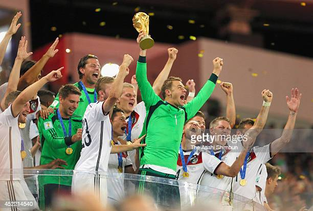 Manuel Neuer of Germany lifts the World Cup trophy during the award ceremony after the 2014 FIFA World Cup Brazil Final match between Germany and...
