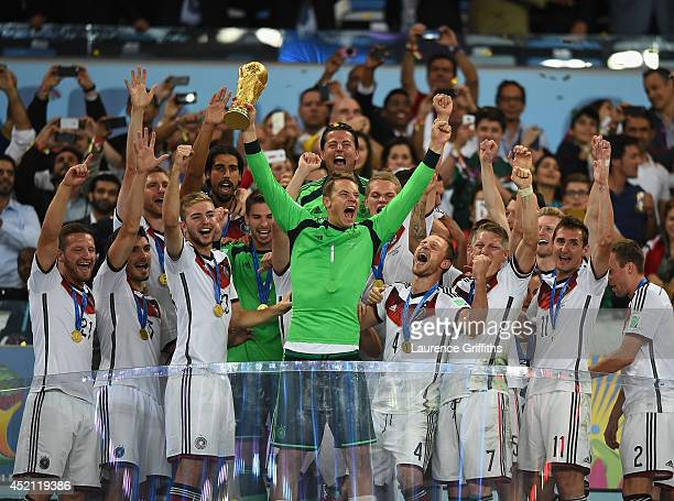 Manuel Neuer of Germany lifts the World Cup trophy with his team after defeating Argentina 10 in extra time during the 2014 FIFA World Cup Brazil...