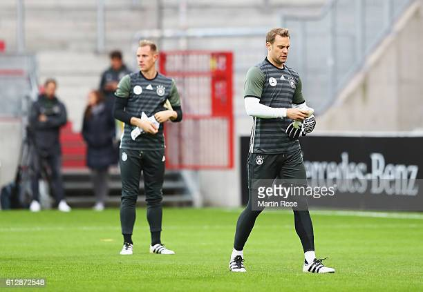 Manuel Neuer of Germany looks on with MarcAndre ter Stegen during a training session at Millerntor Stadion on October 5 2016 in Hamburg Germany